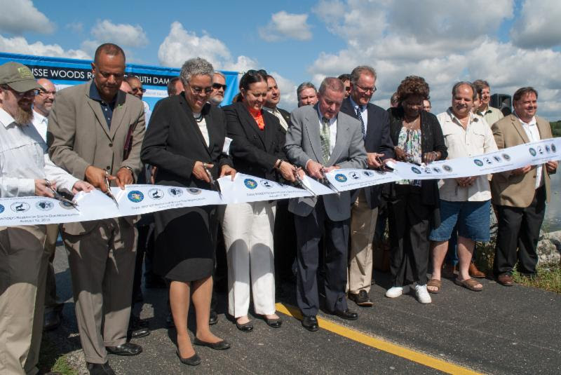 Friends' President Benjamin Cox helps cut the ribbon for the Busse Dam Reservoir Project.