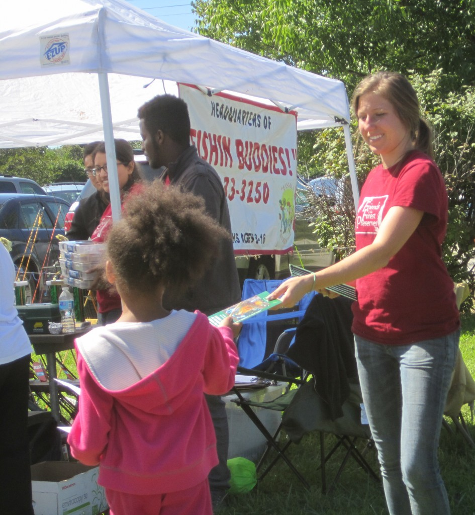 One of our free recreation events in the Calumet region, in partnership with Fishin' Buddies. Here, our Forest Preserve Leadership Corps crew leader, Daiva Gylys, helps hand out awards to participants.