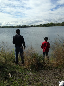 Eduardo Paz helps teach a youngster how to fish at one of our free recreation events in the Calumet.