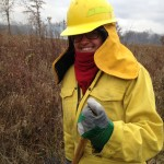 Gloria Orozco helps lead a prescribed burn at McMahon Woods.