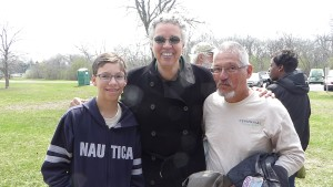 Ron Rodriguez and his son, Alex, meet Forest Preserve District President Toni Preckwinkle on Earth Day.